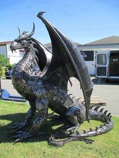 A dragon sculpture made from engine parts by Tom Samui. The Swiss artist has created hundreds of sculptures and statues made entirely from scrap car parts.