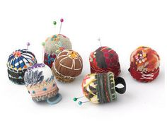 Finger pincushions made from recycled bottle caps and fabric.