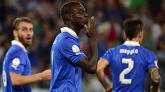 Mario Balotelli celebrates his goal that sends Italy to the 2014 World Cup