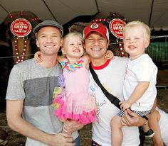 Harper and Gideon are absolutely ecstatic as their dads, Neil Patrick Harris and David Burtka, hold on tight for a cute photo.