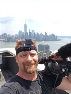 Filming window washers for the fearless documentary from over 500 feet above the sidewalk. If you have a fear of heights you definitely would not want to look over the edge! Across the river you can see the freedom Tower. And maybe you can see in your minds eye the twin towers and never forget. Freedom isn't free. Fear lost. Courage wins.   Scott Goodknight