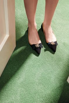 Presenting Gucci shoes for the party season: suede point toe flats with a grosgrain bow and a bee embroidered appliqué.