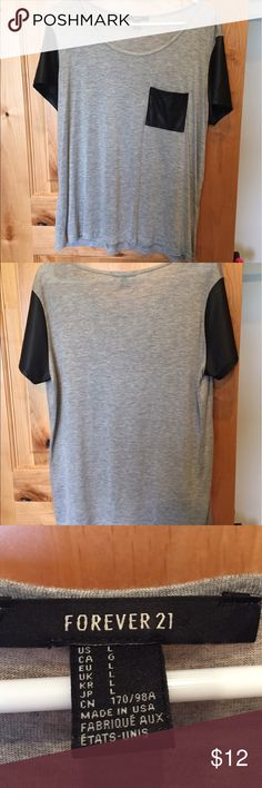 F21 grey tshirt with leather accents Grey tshirt. Leather sleeves. Leather chest pocket. Worn a few times. Make me an offer! Forever 21 Tops Tees - Short Sleeve