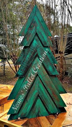 """RECYCLED WOOD PALLET:   Here is our painted and stained Double-Angled Christmas Tree we posted earlier.  We can make more in red, just stain or white. This one is free standing but we can make it with a yard stake. Right now this is the only size we make, it is 45"""" tall x 25"""" wide and we are asking $50. That's painted and or stained. (This has the wood of a double pallet wood tree.) Message us if you would like to place an order.   Item # 1,282"""