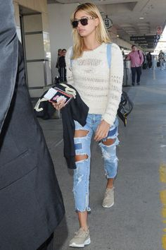 144 ways to style denim or jeans this summer: Hailey Baldwin's shredded jeans.