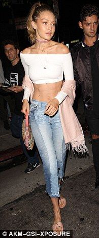 Flaunt it: Gigi Hadid, 21, likes to show off her killer abs in a variety of crop tops and slightly distressed denim