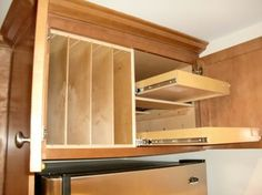 Above Fridge & Oven Solutions - Tray dividers beside a double set of pull out shelves creates usable storage above your refrigerator, making...