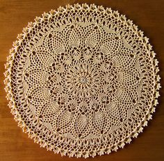 Page 50. This doily is worked in 33 rounds - Perfect Pineapple in the book Absolutely Gorgeous Doilies