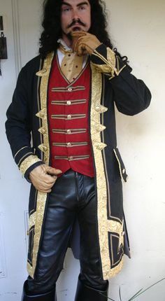 totally awesome jacket!  ~LL. Red Ultra suede and Black Applique Steampunk by dashandbag on Etsy
