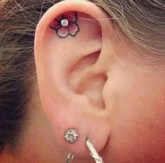 Im not sure what you think about this, but I love it and want it! I would pierce it after the tattoo healed