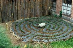 A backyard labyrinth made from slate like stone. Perhaps it will be more for decoration than walking.