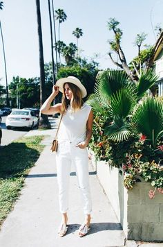 Looking insanely stylish in a bold all white look.