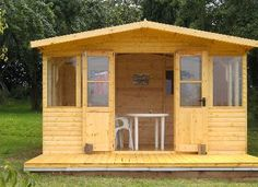 Delighted customer with this quality bespoke summerhouse with decking