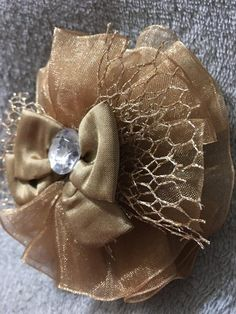 Items similar to Handmade Gold Hair Clip, Fishnet Hair Bow on Etsy Gold Hair Bow, Gold Hair Clips, Hair Bows, Fishnet, Brooch, Trending Outfits, Heavenly, Unique Jewelry, Handmade Gifts