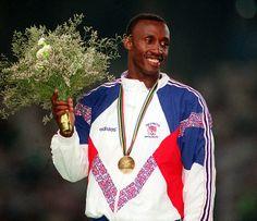 Linford Christie amb la medalla d'or als Jocs OLímpics de Barcelona al 1992.