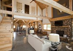 Open floor plan in a barn home with loft living space.  Wood post & beams add style!  www.sandcreekpostandbeam.com https://www.facebook.com/SandCreekPostandBeam