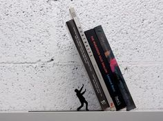 Falling Bookend. awesome visual effect.  Brought to you  by Shoplet Promos- Everything for your business. www.shopletpromos.com