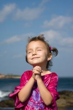 little girl praying and praising God