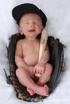 Baseball would be a much more interesting sport if everyone wore THIS uniform.  Side note: Did this baby just sneeze or something? Or maybe he is spitting chew..