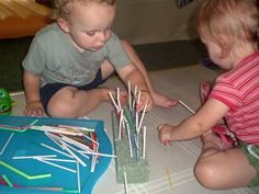 Great For Fine Motor...  Materials:  a block of flora craft Styrofoam (mine was recycled from a recent flower delivery)  drinking straws  lollipop sticks  tooth picks  Popsicle sticks  and lastly...  two busy toddlers in need of something NEW to hold their attention :)