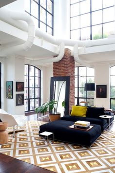 Finding a place with exposed ductwork is like the holy grail for industrial types–you've found something that totally speaks your style, and now you need to know what to do with it
