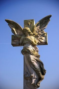 Gothic style statue of an angel on a cemetery
