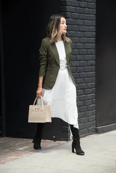 """Petite - Asymmetric midis are a great alternative to maxis for those under 5'4"""". Adapt the silhouette for the office by pairing it with a tailored blazer. Elongate the legs with over-the-knee boots, and further elevate the outfit with a top-handle satchel."""
