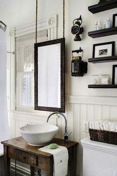 Antonio Martins - Amazing bathroom - salvaged wood vanity - black floating shelves - suspended mirrror