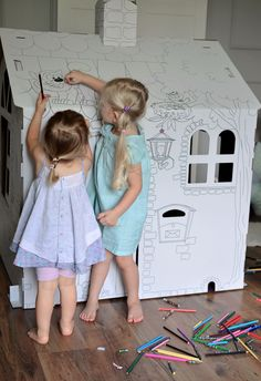 fun winter activity for kids using a big cardboard house