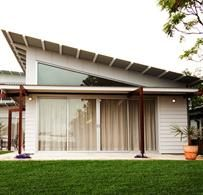 light home - The best weatherboard cladding for the classic weatherboard home. Lots of natural light and flat roof.