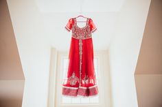Indian wedding reception dress - red and silver salwar anarkali. Photo Credit: We Are Diamond Eyes Photography.