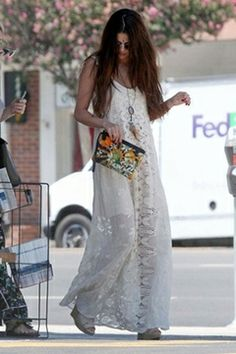 The Jen's Pirate Booty Infinity Dress in Shell, worn by Selena Gomez, is the epitome of boho-chic. This crochet overlay sleeveless maxi dress features a low scoop back with circle crochet trimming around the edges.