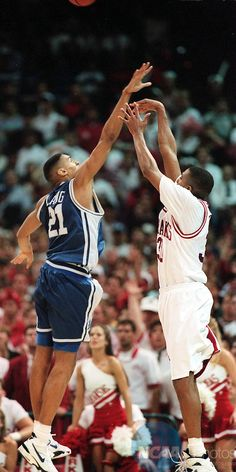 Antonio Lang and Scotty Thurman (Arkansas). Saw this live, shot heard around Arkansas, 1994 NCAA Basketball Champions