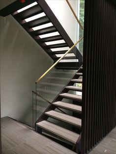 Stairs at 51 Fitzroy park that I made. Brass handrail slotted over glass balustrade is very effective Glass Handrail, Stair Handrail, Glass Balustrade, Floating Staircase, Curved Staircase, Railing Design, Staircase Design, Handrails For Stairs Interior, U Shaped Stairs