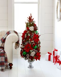Find stunning Christmas decor, from faux florals, wreaths and garlands to gorgeous topiaries, candles, trees, ornaments and gingerbread houses.