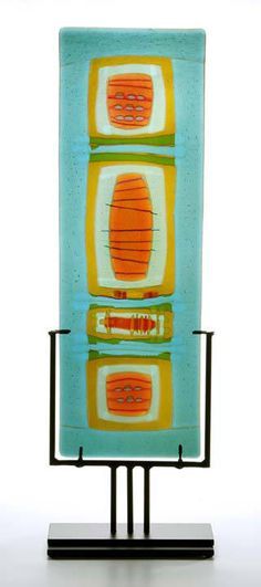 fused glass, dam, turquoise base w/ multi colored glass. metal stand. Latimer Glass Studio