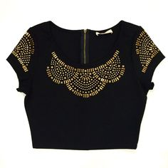 - Quality knit black crop top with embellished neckline and sleeves - Zippered Back - 65% Rayon 30% Polyester 5% Spandex - Made in USA Small Medium Large Bust 16 inches 16.5 inches 17 inches