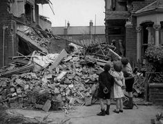 An English boy points out his destroyed room to some friends after surviving the night, 1940