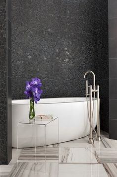 modlin modern master bath | black pebble tile | oval bathtub | marble floors | photo by jeremy enlow | 360 west magazine august 2012