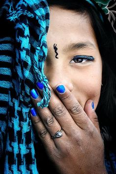 Bhutan  A half portrait of a young Bhutanese lady. Taken in the town square of the peaceful capital city of Thimpu.    David Lazar
