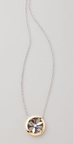 I like simple.    Elizabeth and James, Round Clover Pendant Necklace.