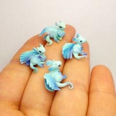 I feel almost like Daenerys, holding these babies....they will be placed in ring holders soon #babydragon #dragons #miniature #fimoclay #polymerclaycreations #polymerclaycharms #gameofthrones #fantasyart #creature #lizard #handmade #dreampet