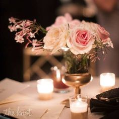 Soft pink roses with a touch of jasmine and delicate lighting #wedding #jasmine #centerpiece #softglow