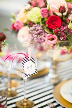 place cards in glasses // photo by Anneli Marinovich Photography, flowers by Brian Kirkby Flowers // View more: http://ruffledblog.com/kate-spade-inspired-wedding-event/