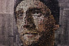Southern California based, German-born Andrew Myers takes hundreds of screws, nails them to a wood panel, and then paints over each screw top to get these interesting, three-dimensional appearing portraits. He takes telephone books pages from the subject's home area and pastes them as the background.