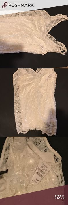 Velvet brand lace sleeveless top Neiman Marcus New lace sleeveless v-neck top with built in cami. Cream color with silver thread through it. Rouched through center for sexy fitted look. Perfect for club wear. Velvet brand, new with tags. Velvet Tops Blouses