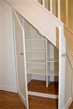 Under stair cabinets with internal storage by cabinet maker 'Gill Martinez' www.gillmartinez.con Manchester, England.