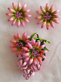 A personal favorite from my Etsy shop https://www.etsy.com/listing/230402927/vintage-enamel-flower-brooch-earrings