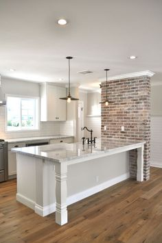 Love the look of exposed brick for an accent wall.