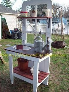 LOVE this idea!... We just tore out an old wood door, so perfect timing in coming across this find!  Home crafts DIY outdoor kids play gardening table Old door w/windows repurposed